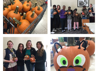 BHC Rhodes and True Light team up for a fun day carving pumpkins