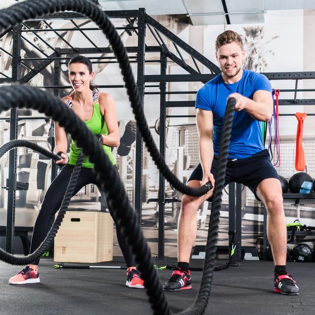 bigstock-Men-with-battle-rope-in-functi-