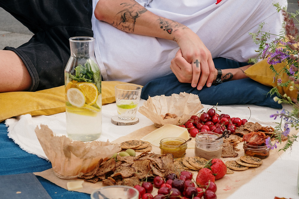 people having an eco picnic charcuterie / fully grown
