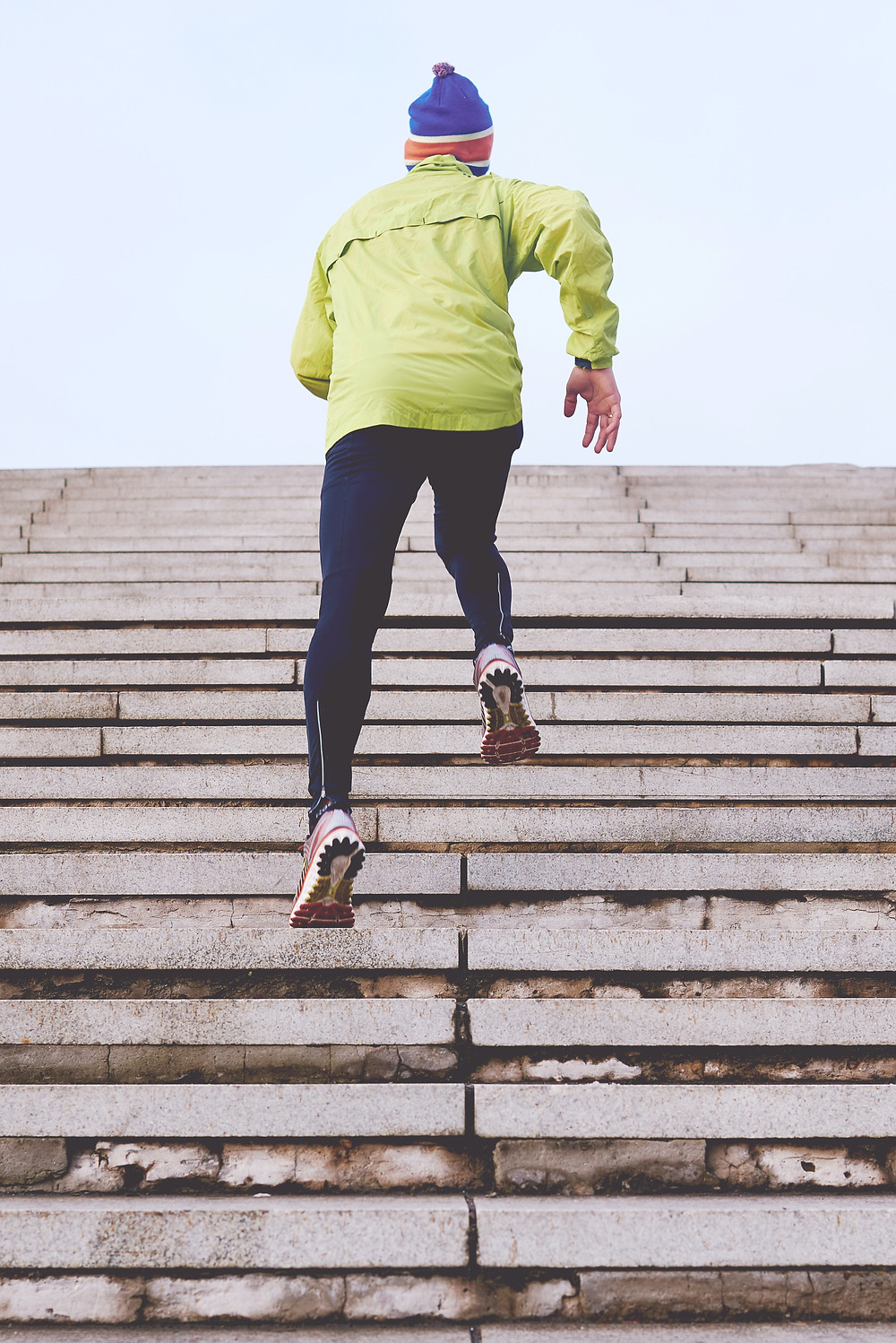 man running up stairs outdoors / fully grown