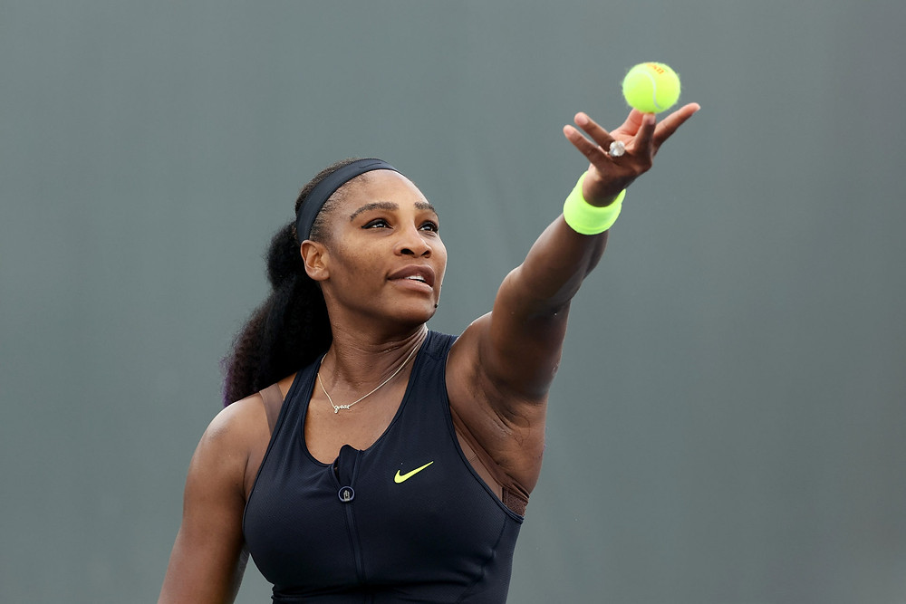 Serena williams serving a tennis match/fully grown