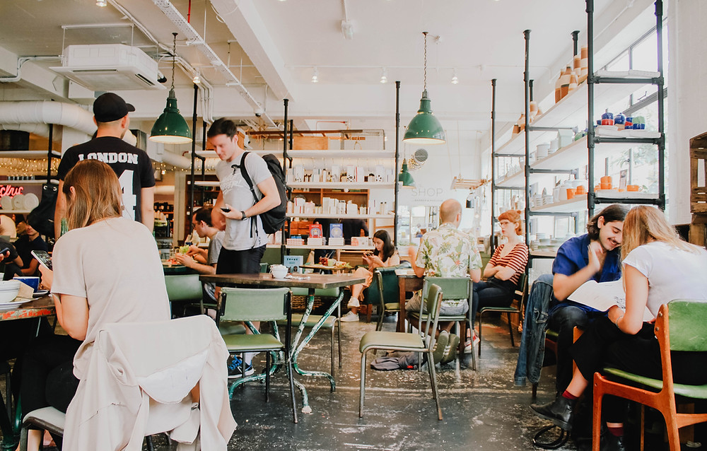 people in a busy, vibrant cafe / fully grown