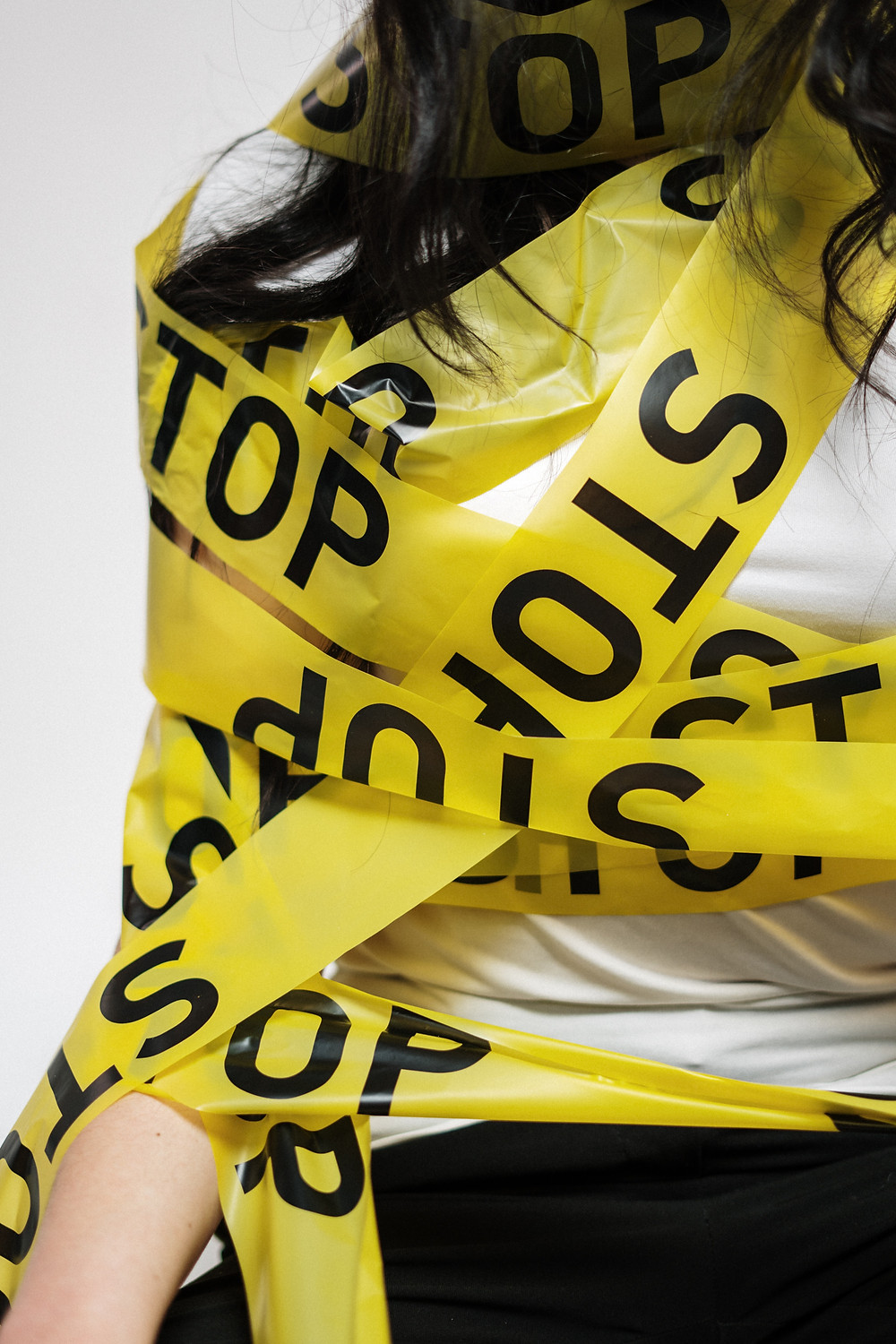 woman with stop caution tape wrapped round her | fully grown