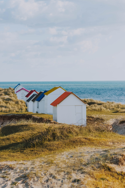 beach huts on sand dunes | fully grown
