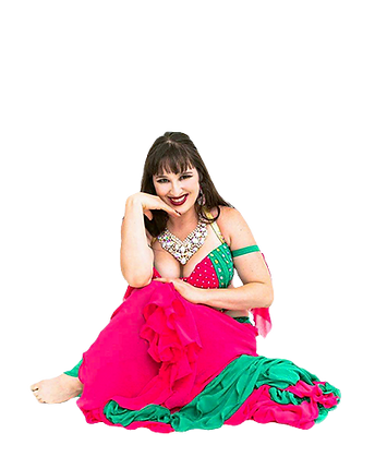 Dancer sitting on ground smiling. Dancer is brunette, wearing a pink and green costume