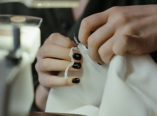 person-holding-silver-and-black-ring-462