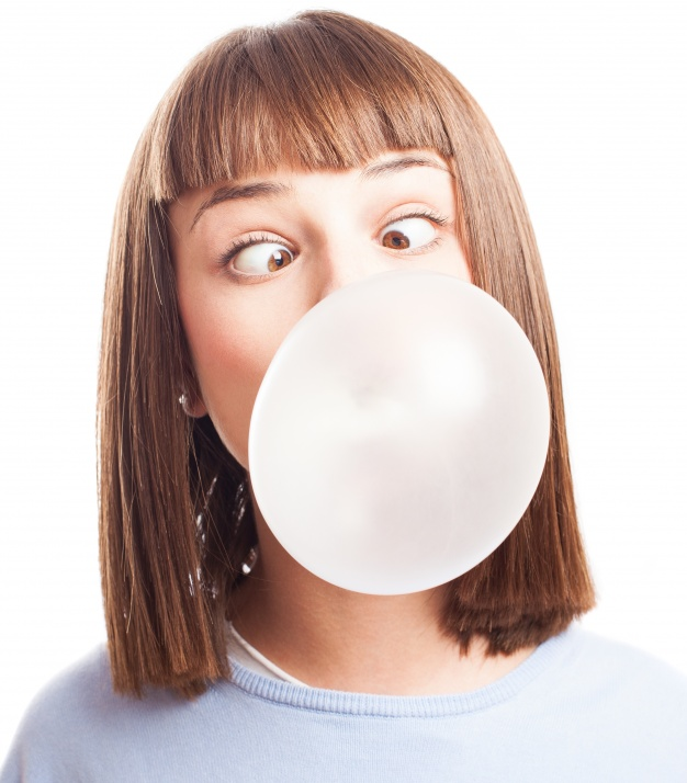 funny-girl-doing-a-bubble-with-chewing-gum_1187-2486