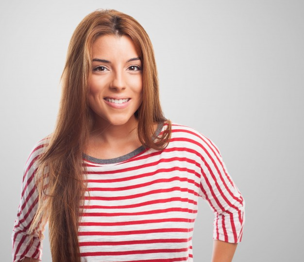 smiling-girl-in-striped-jersey-looking-at-camera_1187-5166