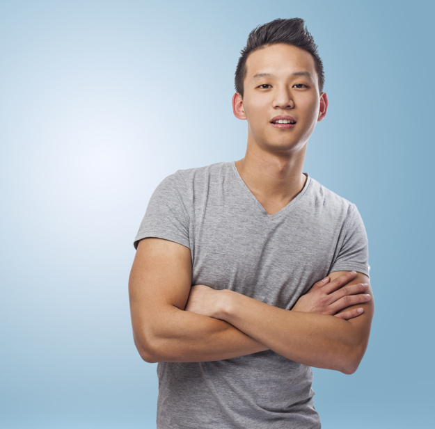 portrait-of-handsome-young-asian-man-standing-over-blue-backgrou_1187-4828