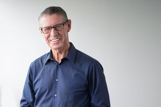 happy-senior-man-wearing-glasses-smiling-at-camera_1262-1857