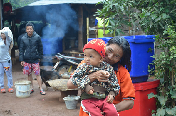 A Shan family in Thailand gets ready for the day.