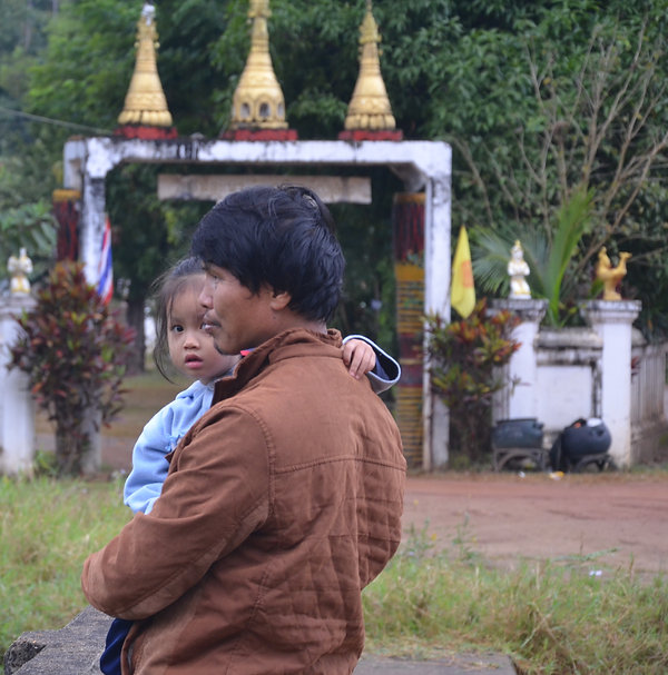 A Shan father and daughter enjoying the cool morning air in Thailand.