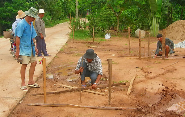 Laying out a fence in Thailand.