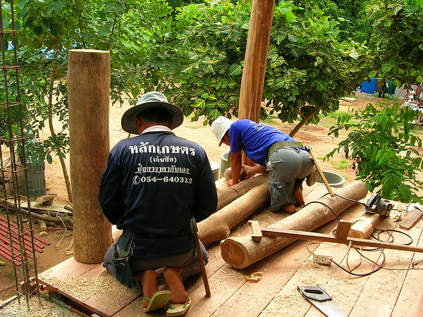 A handicapped worker in Thailand building a house.