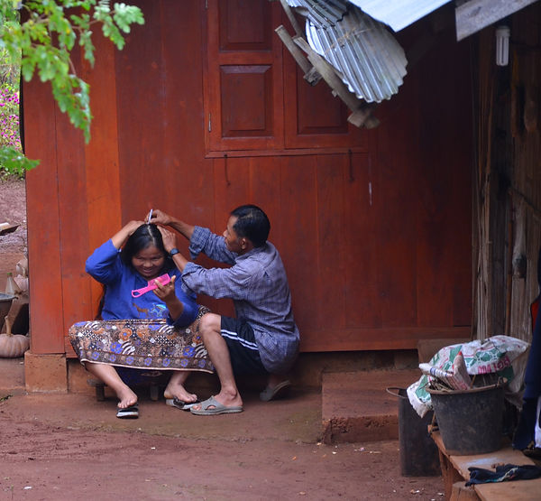 A Thai husband helping his wife to lose the grey.