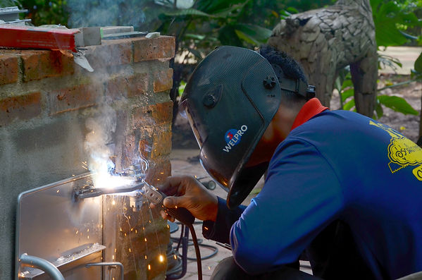A welder in Thailand builds a smoker.