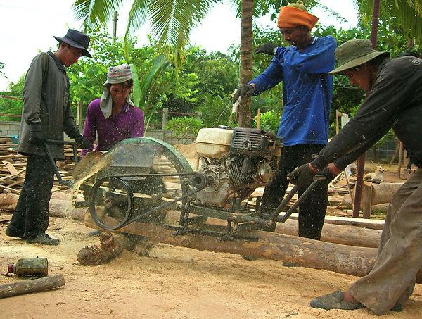 Planing teak logs in Phitsanulok, Thailand.