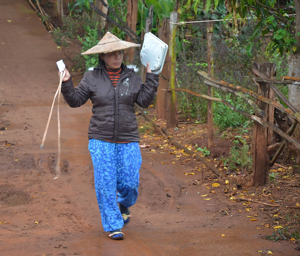 A nurse from the Shan tribe in Thailand is making her weekly rounds.