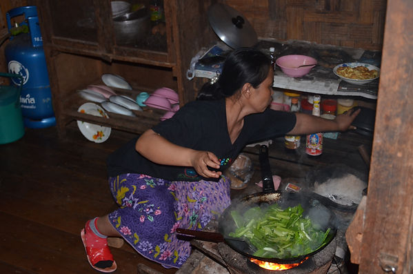 A Shan lady is cooking dinner for her guests.