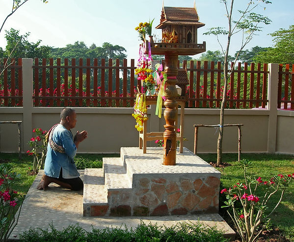 The local shaman dedicates a spirit house in Thailand.