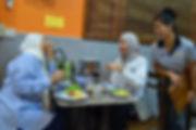 Muslim ladies enjoying a meal in Thailand.