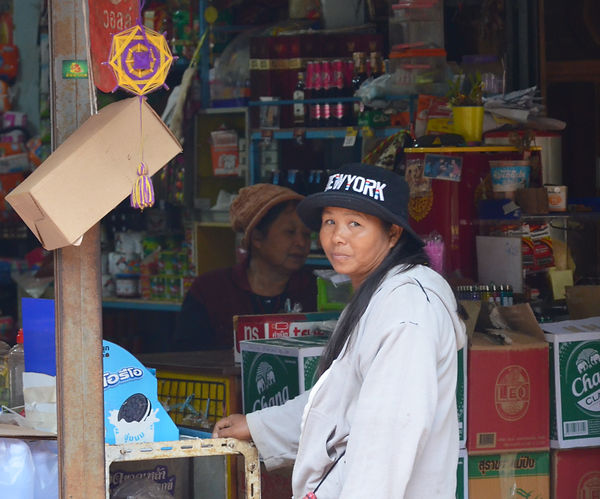 A Shan woman shopping at the local market in the village in northern Thailand.