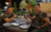 Soldiers in the Thai Army enjoying a meal.