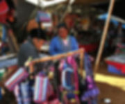 A grandfather shopping at a market in northern Thailand.