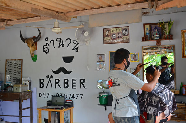 A barber in Thailand.