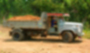 What is a dump truck delivering dirt to D&G Resort in Thailand.