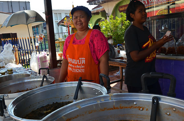 Vendors selling food in Thailand.