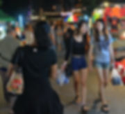 Shopping at a night market in Phitsanulok, Thailand.