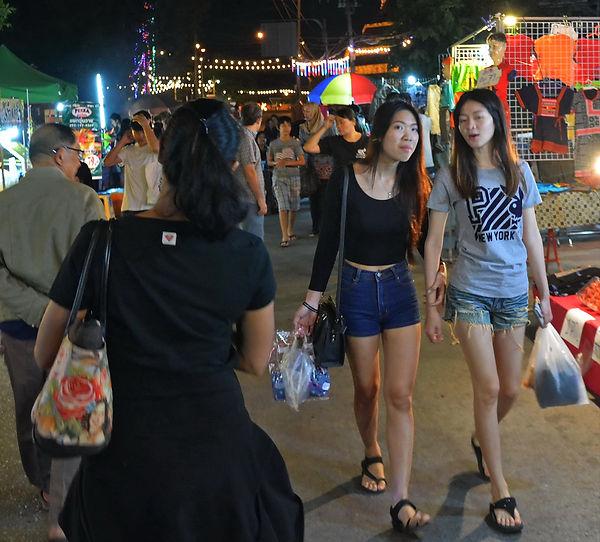 Shopping at a night market in Phitsanulok, Thailand.
