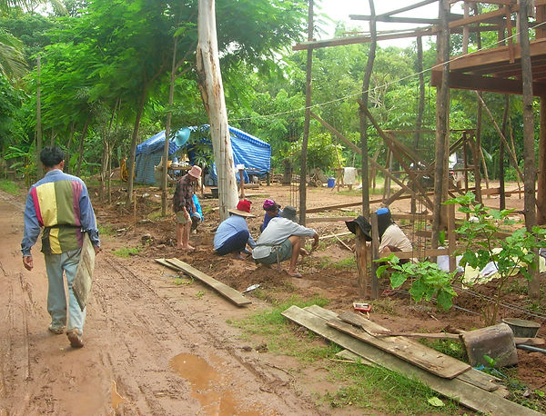 Laying out forms for a fence in Thailand.