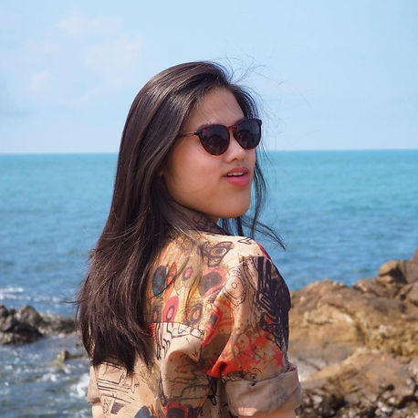 A young Thai lady on the seashore in Thailand.