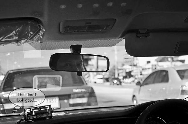 Riding in a taxi in Bangkok.