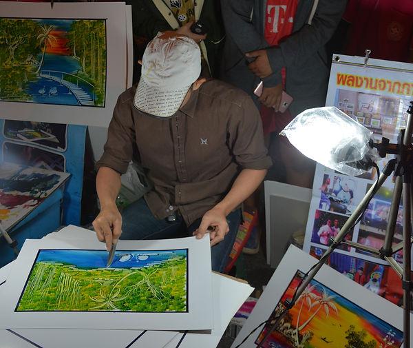 A local artist in Thailand.