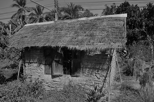 This house is made out of rice straw and mud. It has been in this village as long as I have. Never been used for anything. The people who live nearby replaced the roof about five years ago because they didn't want to see Mother Nature take over.  ​  The problem is that nobody knows who built it or why.