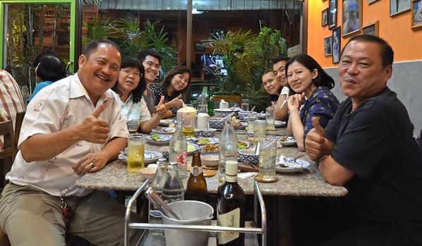 A Thai family enjoying eating dinner at D&G Restaurant.
