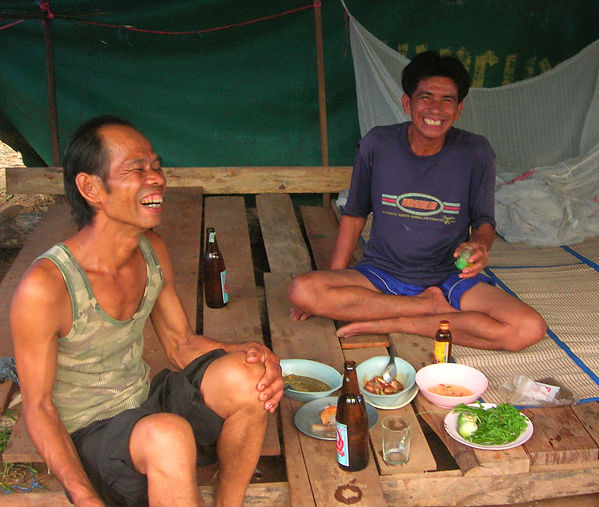 Thai construction workers enjoying dinner and drinks.