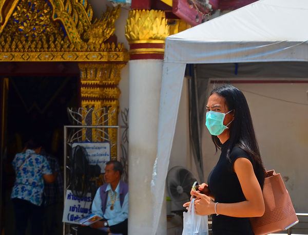 Visiting a Thai temple during lunch hour.