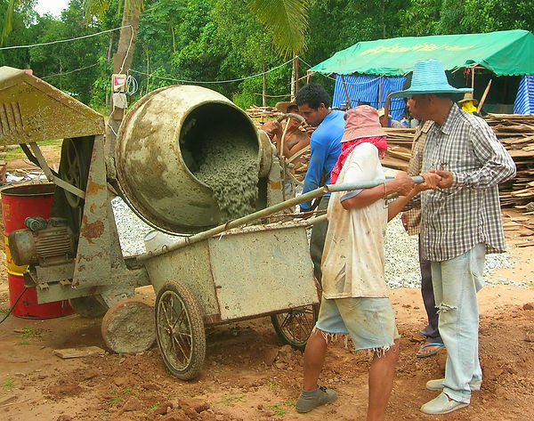 Mixing concrete in Thailand.