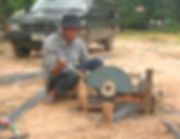 Cutting rebar in Thailand.