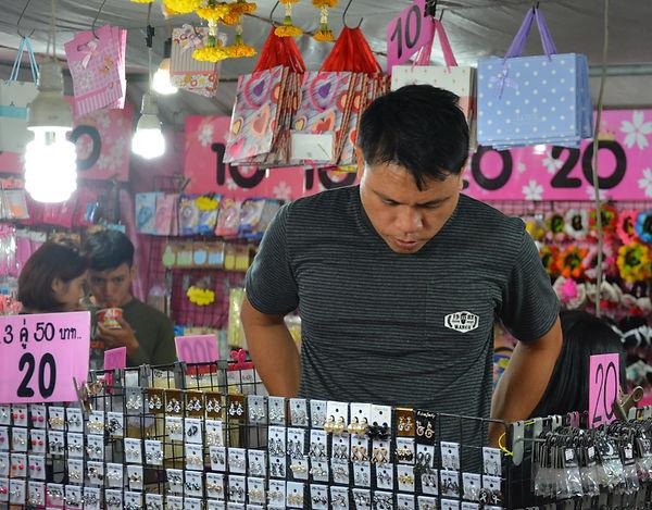 Choosing jewelry in Thailand.