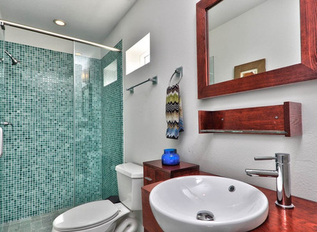 Baths with Vibrant Blue & Green Shower Tiles