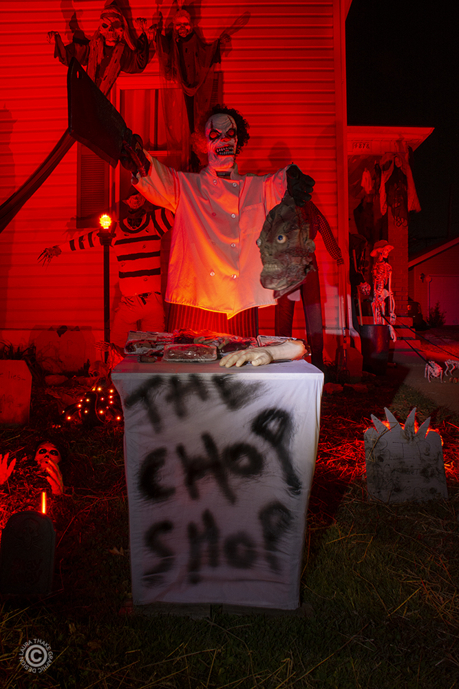 Halloween butcher chopping body parts.