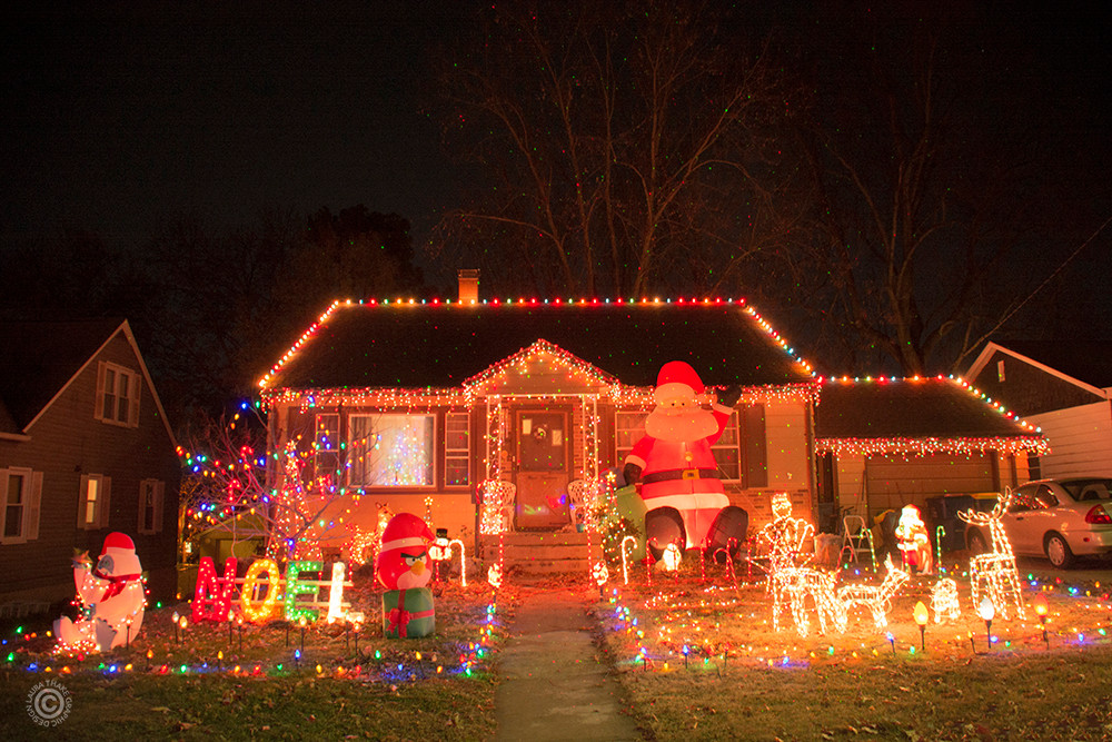 Christmas lights covering a house and yard with colorful holiday cheer.
