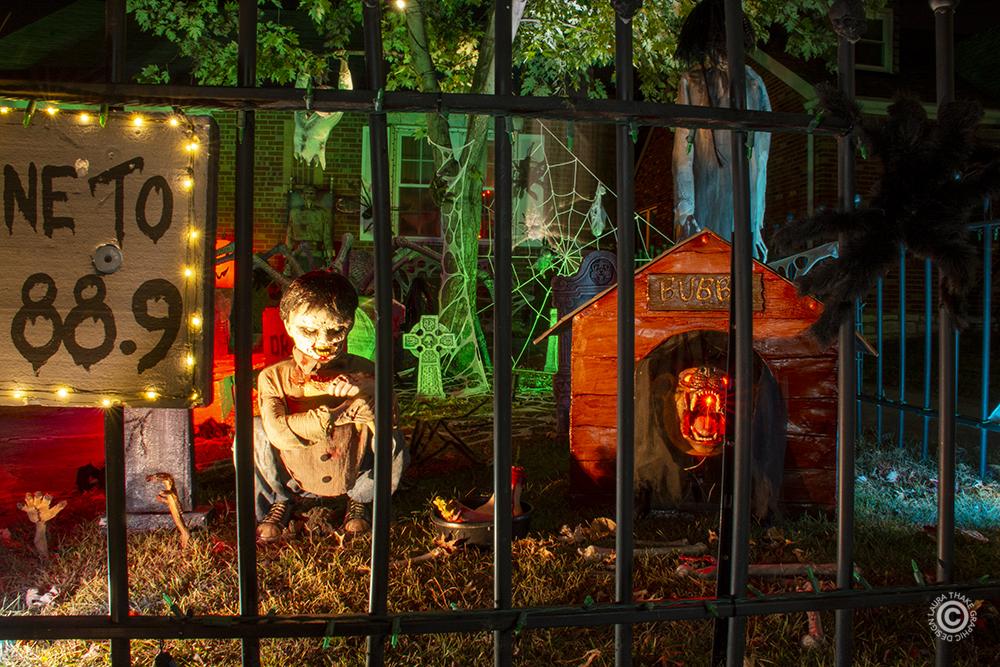 Creepy Halloween little boy feeding his dog.
