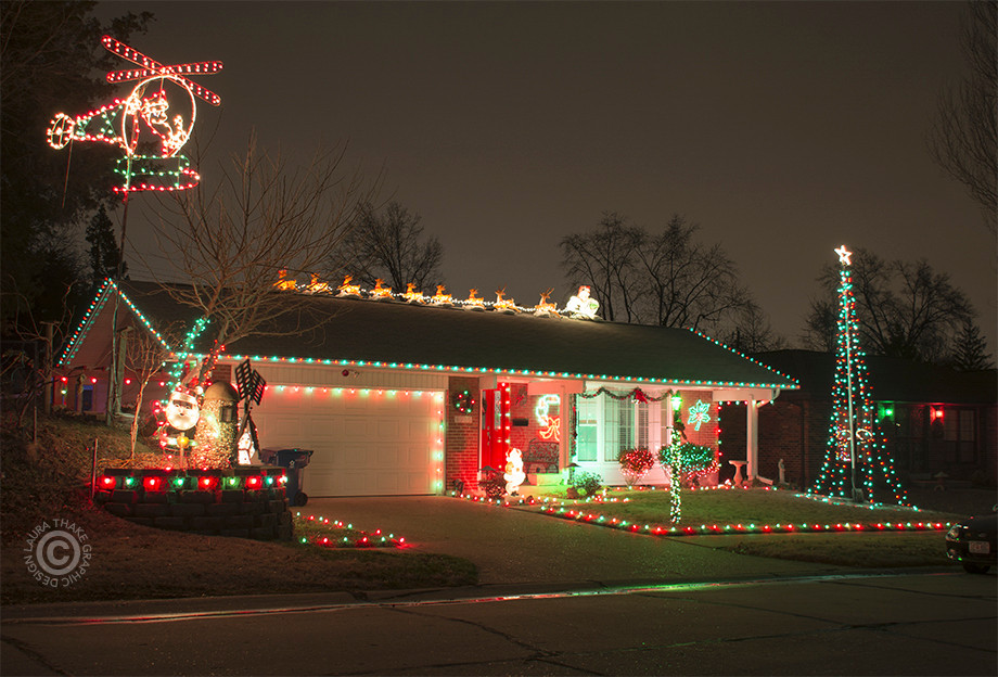 Christmas lights on a house in Affton with Santa in his helicopter.