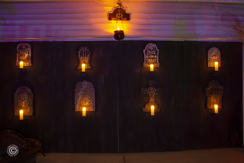 The home made mausoleum covering their garage doors is extra Halloween creepy.